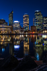 View of the Spanda Sculpture and Perth's CBD Skyline at night.