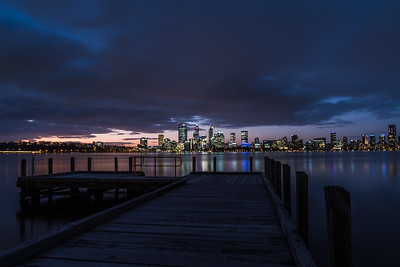 View of Perth City skyline from South Perth Foreshore at dusk.