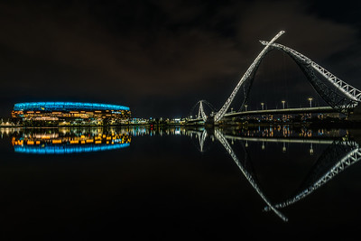 Reflection of Optus Stadium and Matagarup Bridge.