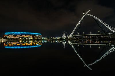 Reflection of Optus Stadium and Matagarup Bridge.