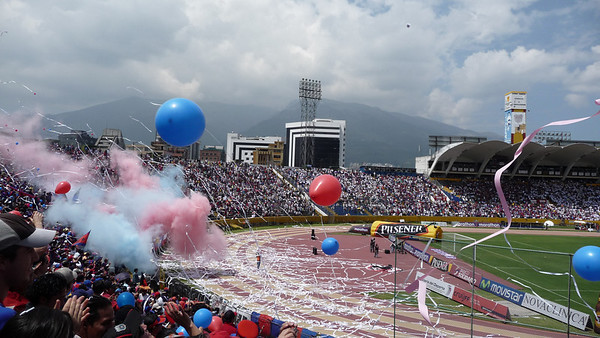"The stadium erupts as Deportivo scores.  Incredible Fútbol match on our 2nd day in Quito.   Intense rivals in the biggest game of 40 years for Quito.  Deportivo stood to win the national championship if they won the game, and ""Liga"" were the current champions of all of the Americas.  Learned great chants (for Deportivo):  ""Y dalle, y dalle, y dalle Quito dalle."""
