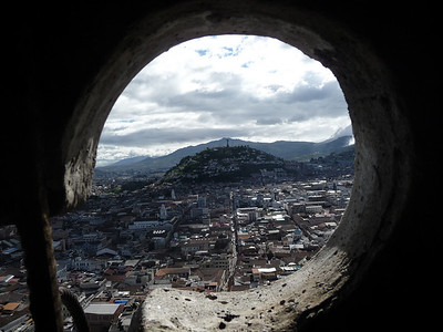 Looking out from the Basilica you get a variety of shapes to frame your view of Quito.  The Virgin of Quito on the hilltop!