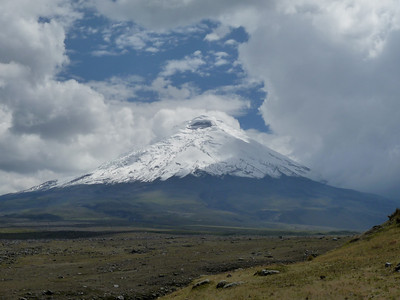 "Behold, Cotopaxi!    50 miles south of Quito, 2nd highest peak in the country, and among the highest active volcanoes on the planet.  It has one of the few equatorial glaciers in the world, and is part of the ""Pacific Ring of Fire"" set of volcanoes.  Peak elevation over 18,000 ft.  It is still considered ""active"".  Most recent violent eruption was 1877, and minor activity (no output) as recent as 1975.  The biggest risk of an eruption is actually the flow of ice from it's glacier, which could wipe out much of Quito, population 1mm."