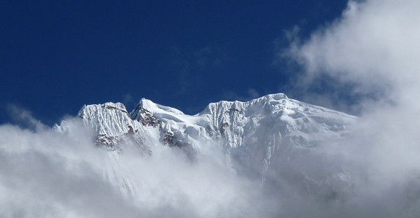 Clouds roll in by mid morning and completely enshroud the mountain.