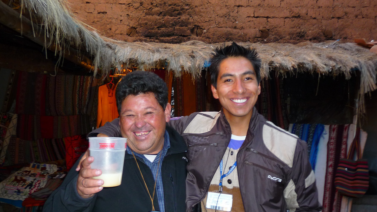 "This our tour guide on the right (Marco Antonio), and our bus driver on the left (Roberto), that's right, the one getting sauced on the local juice - ""Chi Cha"" - fermented and potent."