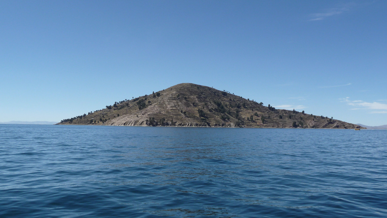 "Approaching the island of Tequile.  I read all of Paolo Coehlo's ""The Alchemist"" on this gorgeous 4 hour boat trip."