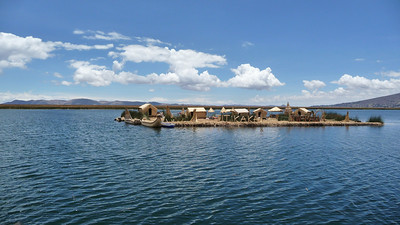 The first thing you come upon in Lake Titicaca are man-made islands, or Uros, near the port town of Puno.  Made entirely of reeds.