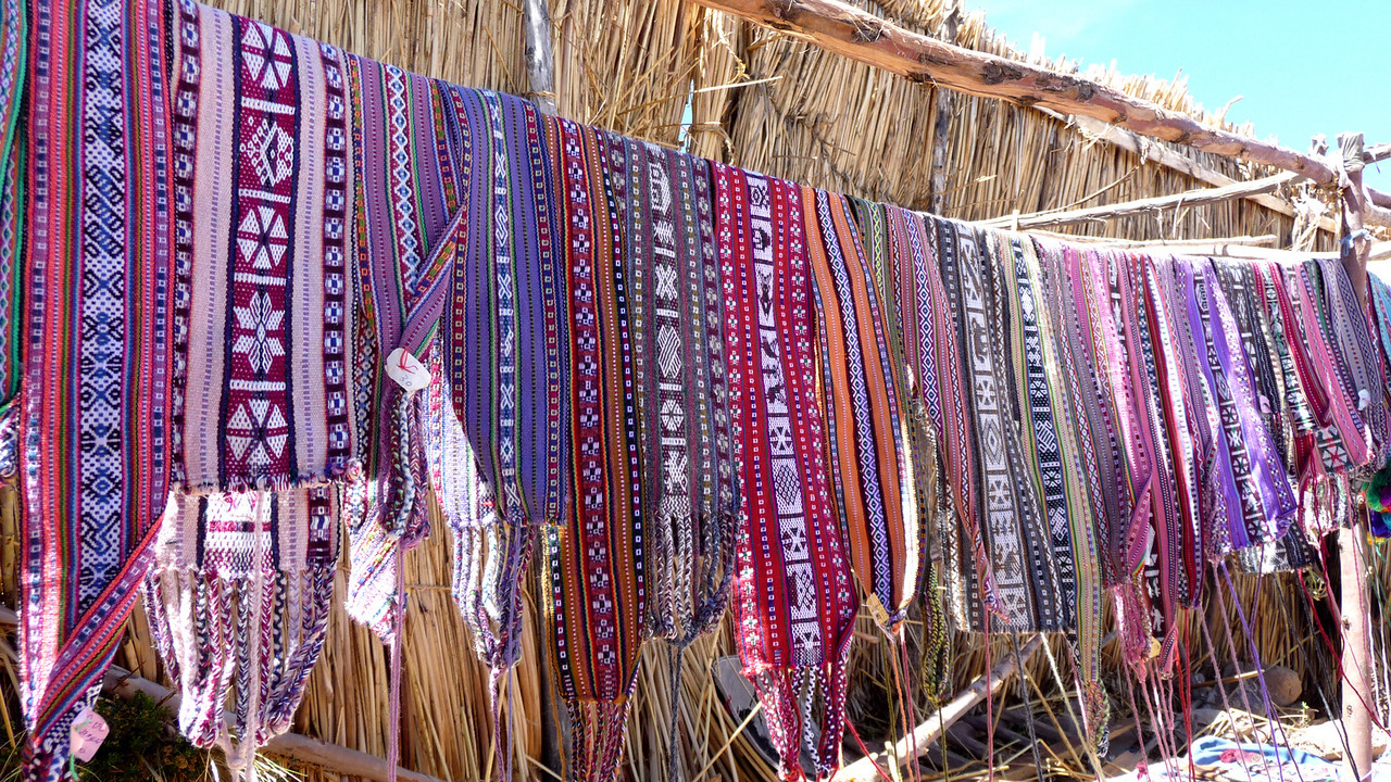 Hand-woven belts and hat wraps, from the local young boys.