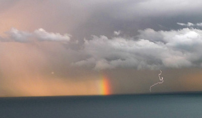 Caught in an electric storm with rainbow, and some good timing on the camera.