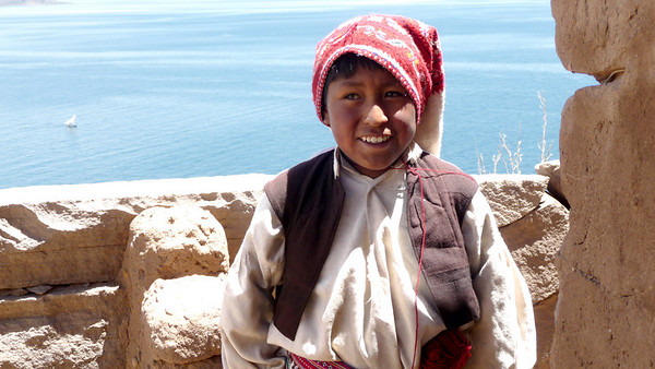 Life is simple and often happy on the island.  Notice the hat.  Little boys wear them and their coloring and length depict whether the boy is single or taken.