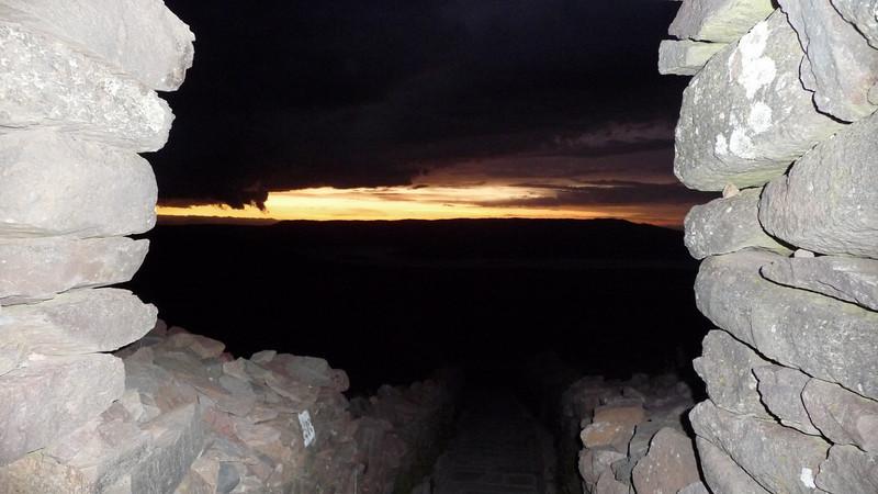 From atop Pacha Tata (peak), the sun's final rays.
