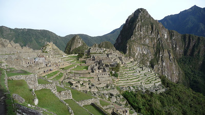 Machu Picchu is at 8,000 ft elevation, on a mountain ridge above the Urubamba Valley (and river).