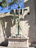 Crucifix with ladder, spear and sponge outside the church