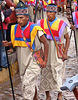 The procession travels through the crowded streets of Cusco