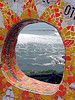 View of the Pacific through one of the colourful mosaic park benches, in a style after Gaudi