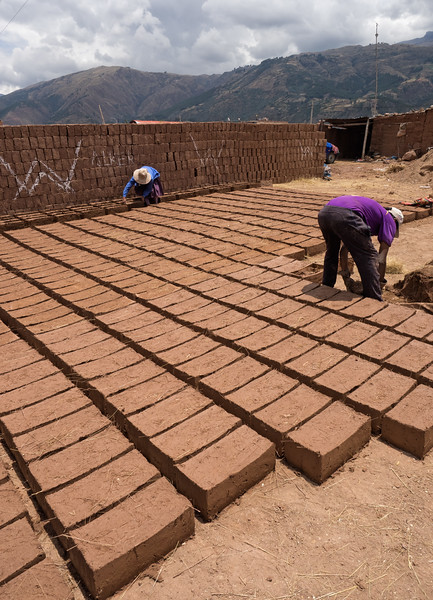 A husband and wife team making mud bricks.  Many homes and other buildings in the area are still made of mud bricks.