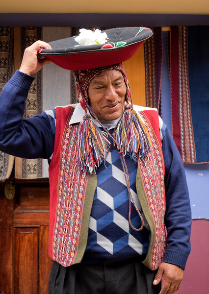 This gentleman runs the weaving cooperative in Chinchero.  Here, he shows a special kind of hat that is worn by the mayor of a community.  Community members take turns being the mayor.