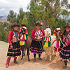 "These ladies and their llamas are professional ""posers"" who stationed themselves at a popular scenic overlook in the Sacred Valley."