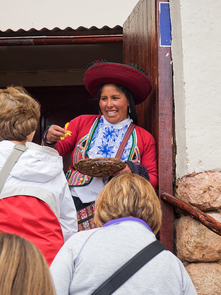 Visitors to a weaving cooperative in the mountain village of Chinchero are greeted with a scattering of yellow flower petals on their heads.