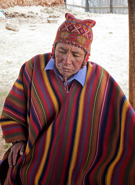 "A ""curandero"" (healer) getting ready to perform a ceremony in which he will pray and make an offering to ""Pachamama"" (Mother Earth).  The next photo shows the offering."