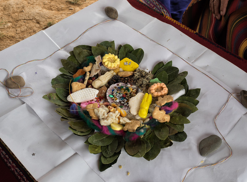 This is the curandero's offering to Pachamama.  Each item in the offering has a symbolic meaning, and coca leaves are spread around the outside.  The paper is then folded around the offering, tied up, and burned.  The smoke from the burning of the offering spreads out over the land, and this is how Pachamama accepts the offering.