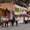 A procession honoring the Virgin Mary passes through a village in the Sacred Valley.