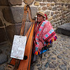 "This man's sign reads: ""Hello, my name is Juan Diego.  I am blind.  I will play you a song from my ancestors.  Thank you for your donation.""  He was sitting right outside the entrance to the ruins at Ollantaytambo."