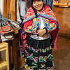 A shopkeeper who sells sweaters at a hotel in Urubamba.