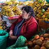 This woman is selling coca leaves from the Amazon.  She drives 4 hours  from her home in the Amazon area to a village in the Sacred Valley, where she sells the coca leaves at this market.