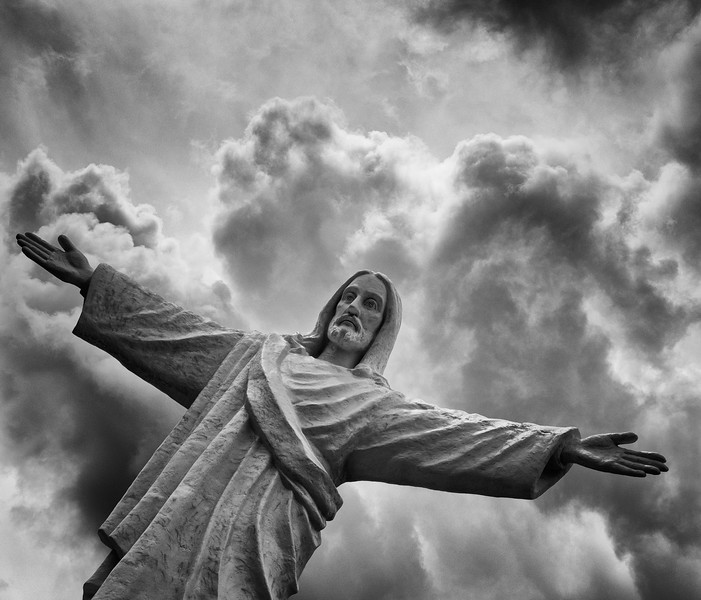 Statue of Jesus in Cusco, Peru, with some added drama from the clouds.