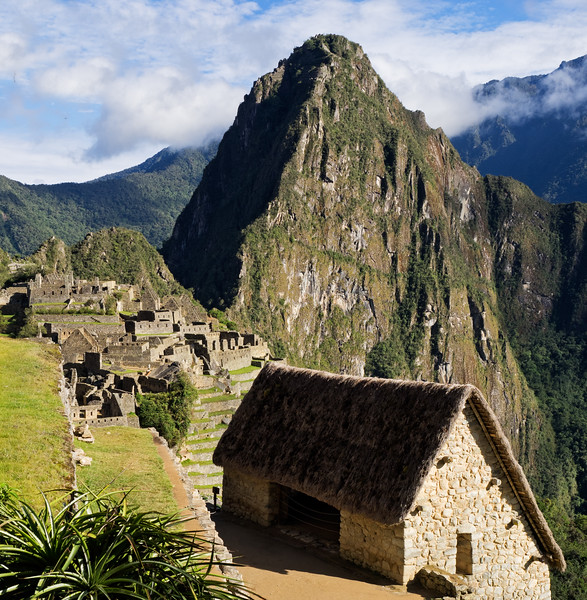 This is one of my favorite images of Machu Picchu.  I like the way the roof repeats the shape of the mountain.
