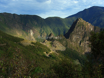 Early morning light shines on Machu Picchu.  When you hike the classic trail, you race on the last day to get to the Puerta Del Sol (the gate of the sun) to see the famous ruins at sunrise.  We just missed true sunrise but this light did not disappoint.