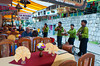 An outdoor restuarant with colorful table setting and entertainers in Agua Calientes, Peru.