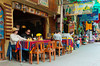 Colorful outdoor restaurant table settings and tablecloths in Agua Calientes, Peru.