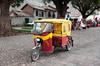 Tricycle transportation in the Urubamba Valley village of Andahuaylillas, Peru.