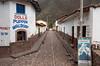 A village cobblestone street in Andahuaylillas in the Urubamba Valley, Peru.