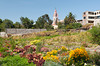 Flower gardens and the exterior of the Recoleta Church in Arequipa, Peru.