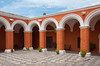 Interior courtyard with arches and architecture of the Santa Catalina Monastery in Arequipa, Peru, South America.