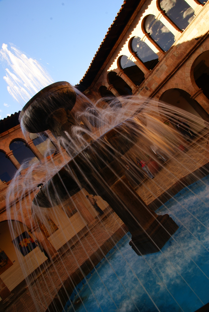 http://nomadicsamuel.com : A photo of a spouting fountain captured with motion blur caused by a slow shutter speed in Cuzco, Peru - travel photo from Cusco