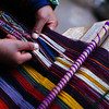 "A lady demonstrates the art of hand weaving with vibrant colors - Sacred Valley, Cuzco - Peru.  Travel photo from Sacred Valley, Cusco - Peru. <a href=""http://nomadicsamuel.com"">http://nomadicsamuel.com</a>"