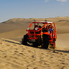 Today's daily travel photo is of a group of tourists ripping around the sand-dunes in a dune-buggy at Huacachina oasis located near Ica, Peru.