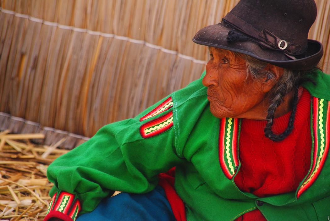 Uros Lady sitting down in Lake Titicaca