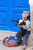 A young Peruvian boy with his pet lamb in the Pisac market, Urubamba Valley, Peru, South America.