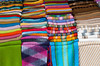 Closeup of colorful blankets and textiles in the street markets of Pisac, Urubamba Valley, Peru, South America.