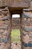 Door opening at the archeological ruins of the Temple of Wiracocha in Racchi, Peru, South America.
