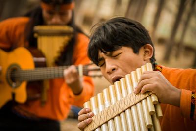 Peruvian musicians in forest near Cusco Peru