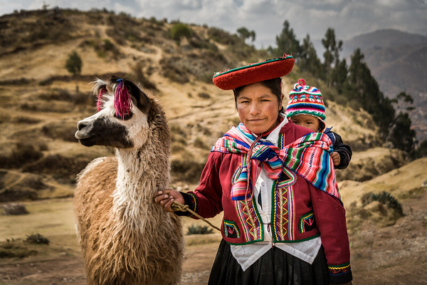 Lady with baby and llama - near Cusco Peru