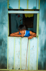 Teenage boy poses for a photo, Iquitos, Peru, South America