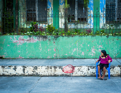 Senior woman about to get up from her chair, Iquitos, Peru, South America