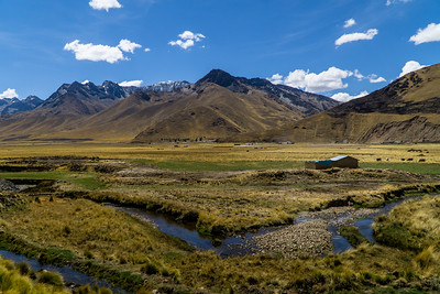 View of the Andes, a River, and a Farm from the Orient Express in Peru